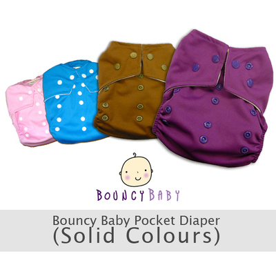 6 - pcs Bouncy Baby One Size Pocket Diapers. Set of 6pcs Diapers & 6pcs Single Layer Bouncy Baby Microfiber inserts. Solid Colors Pink/Blue/Brown/Purple As seen in Photo. (BUY AS IS SECTION)
