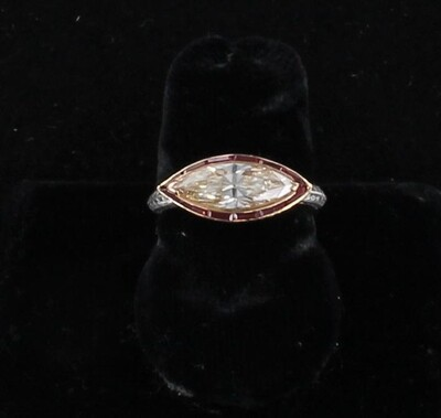 18KT 1.15 CT MARQUISE DIAMOND AND RUBY RING