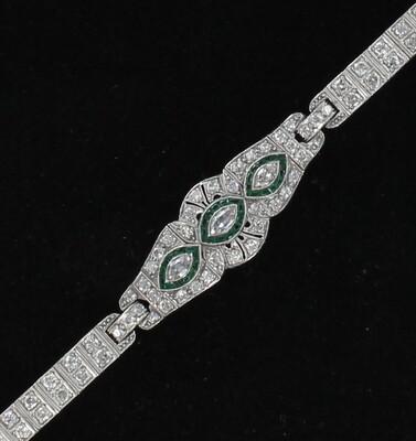 PLATINUM DIAMOND EMERALD BRACELET, CIRCA 1920
