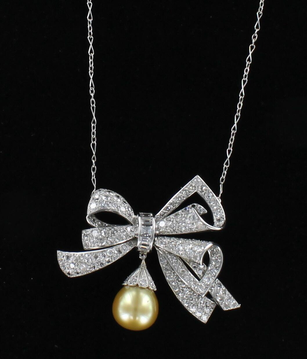 PLATINUM DIAMOND BOW WITH GOLDEN PEARL NECKLACE