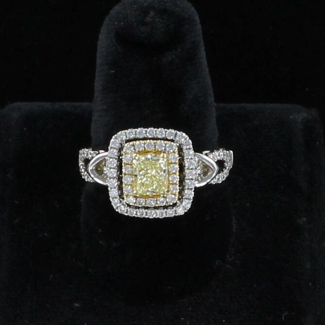 18KTW .90 CT FANCY YELLOW RADIANT CUT DIAMOND RING
