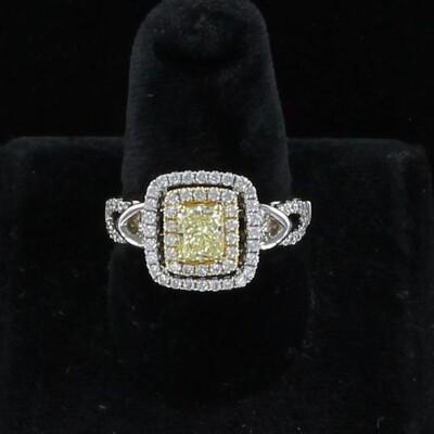 18KTW .90 CT FANCY YELLOW RADIANT CUT DIAMOND RING