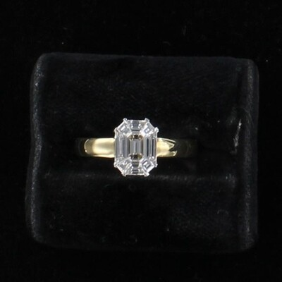 18KT .70 CT TW EMERALD-CUT DIAMOND ENGAGEMENT RING