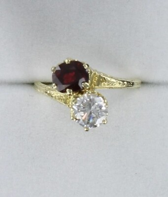 14KTY DIAMOND AND RUBY BYPASS RING