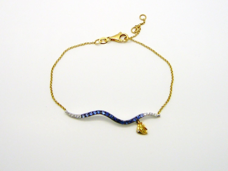 WAVE / FISH BRACELET,  14 Kt. Gold / Blue Sapp.