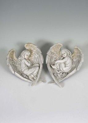 2 assorted sleeping angels