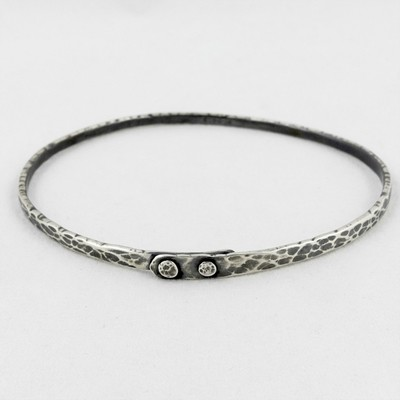 Ripple Silver Rivet Bangle, by Evie Milo