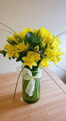 Spring Daffodils hand tied in a clear glass vase