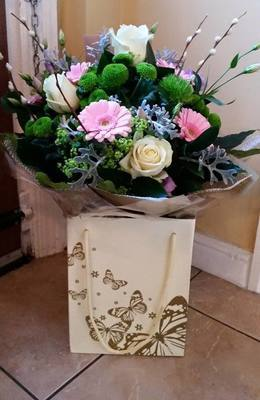 Large luxury hand tied aqua packed in a butterfly bag