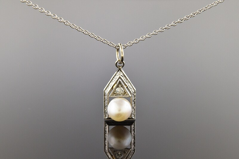 14 karat white gold stick pin conversion pendant with one pearl and one diamond.