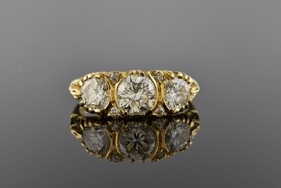 Three Stone Diamond Ring With Carved Details