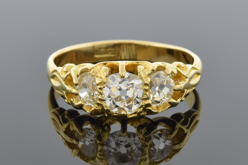 Antique English Three Stone Ring with Old Mine Cut Diamonds
