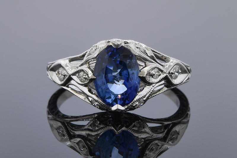 Bright Sapphire Ring with Modern Art Deco Details