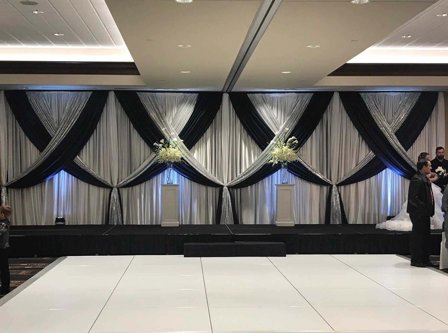 Navy Satin Accented with Silver Glitz on White Sateen Backdrop
