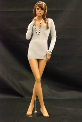 Beauty Female mannequin, elegant stance with crossed legs.