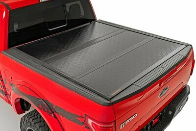 Nissan Low Profile Hard Tri-Fold Tonneau Cover (05-20 Frontier | 5' Bed W/ Factory Cargo Management System)