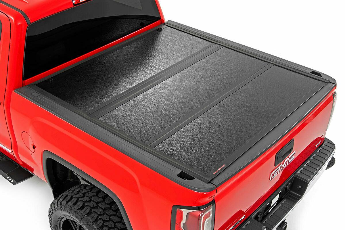 GM Low Profile Hard Tri-Fold Tonneau Cover (14-18 1500, 15-19 2500/3500 HD | 5.5' Bed W/ Rail Caps)