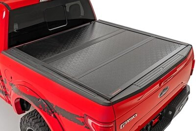 Toyota Low Profile Hard Tri-Fold Tonneau Cover (02-19 Tundra | 5.5' Bed W/ Factory Cargo Management System)