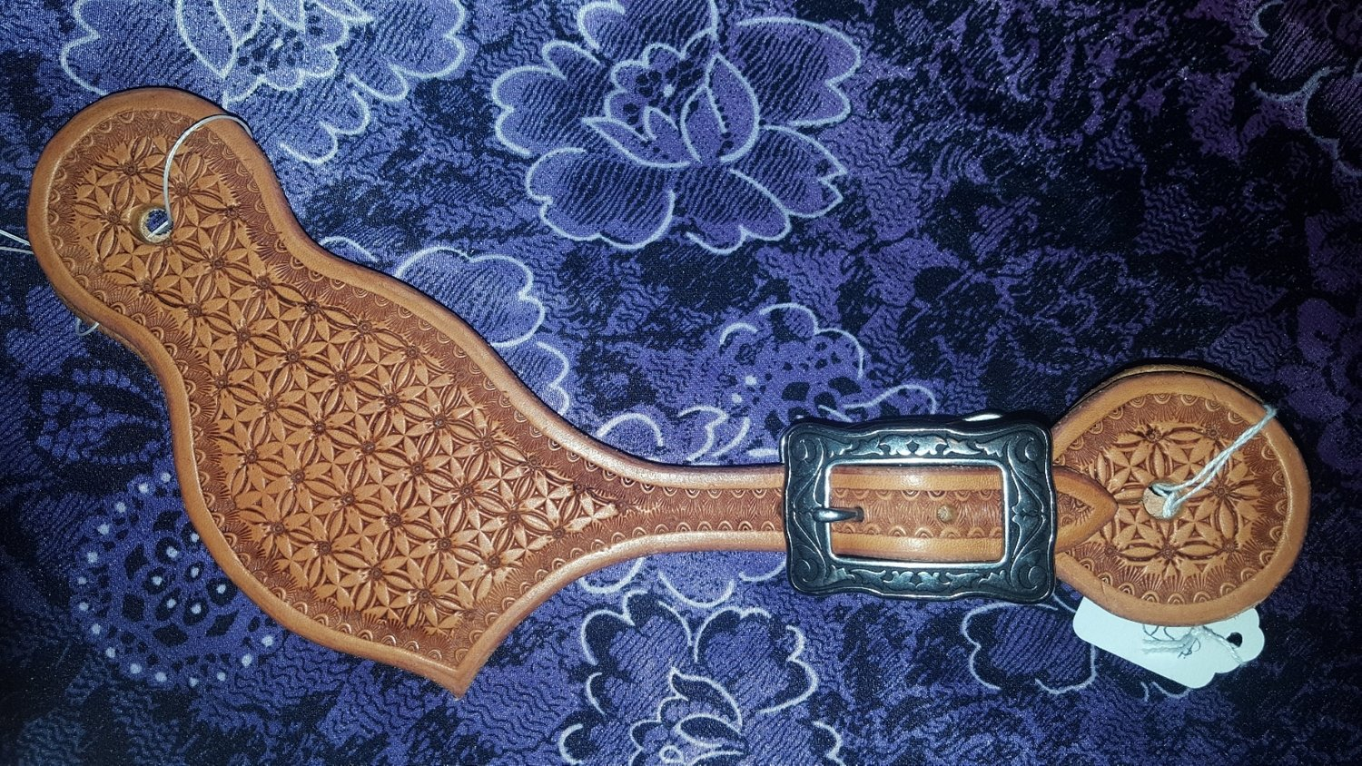 Geometric stamped spur straps