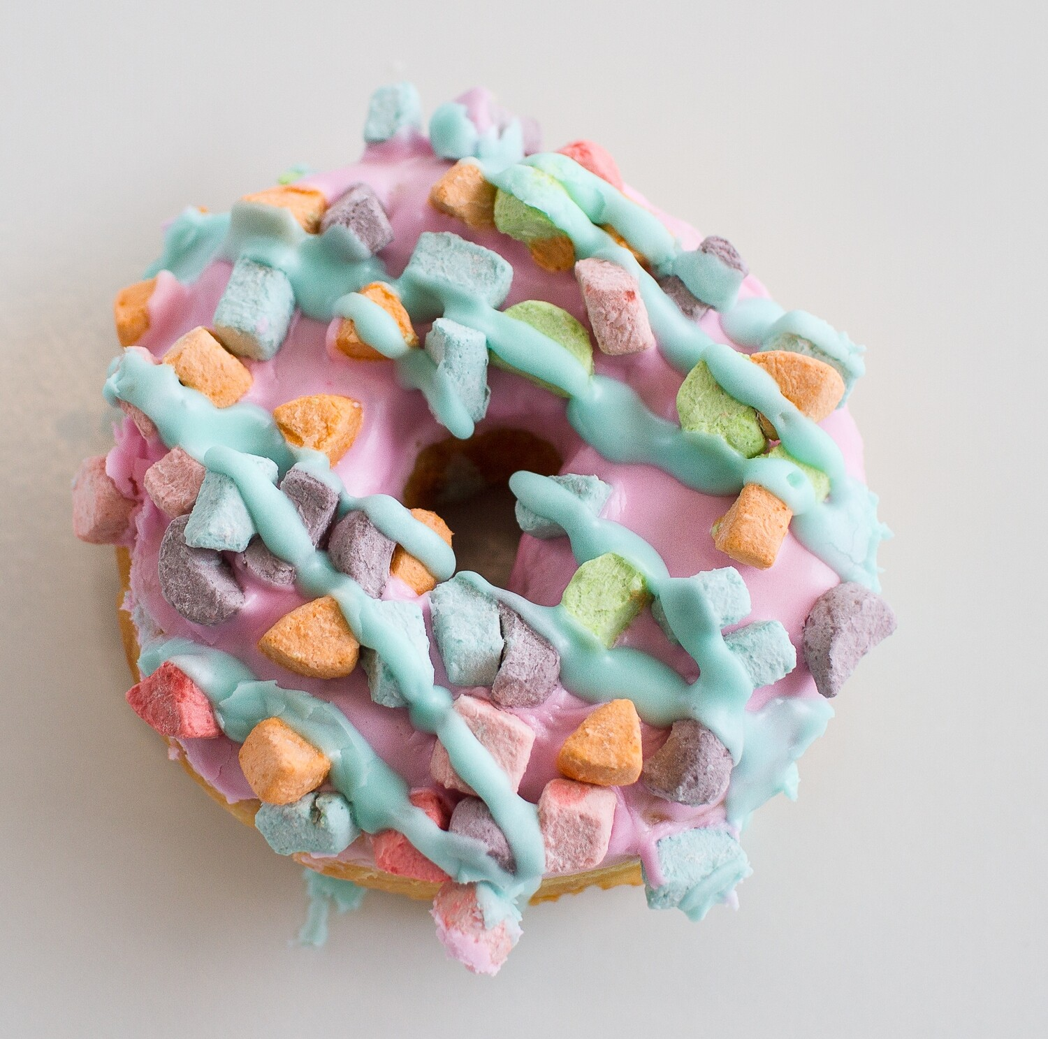 Yeast Donut, Vanilla Icing, Lucky Charm Topping (Single Donut)