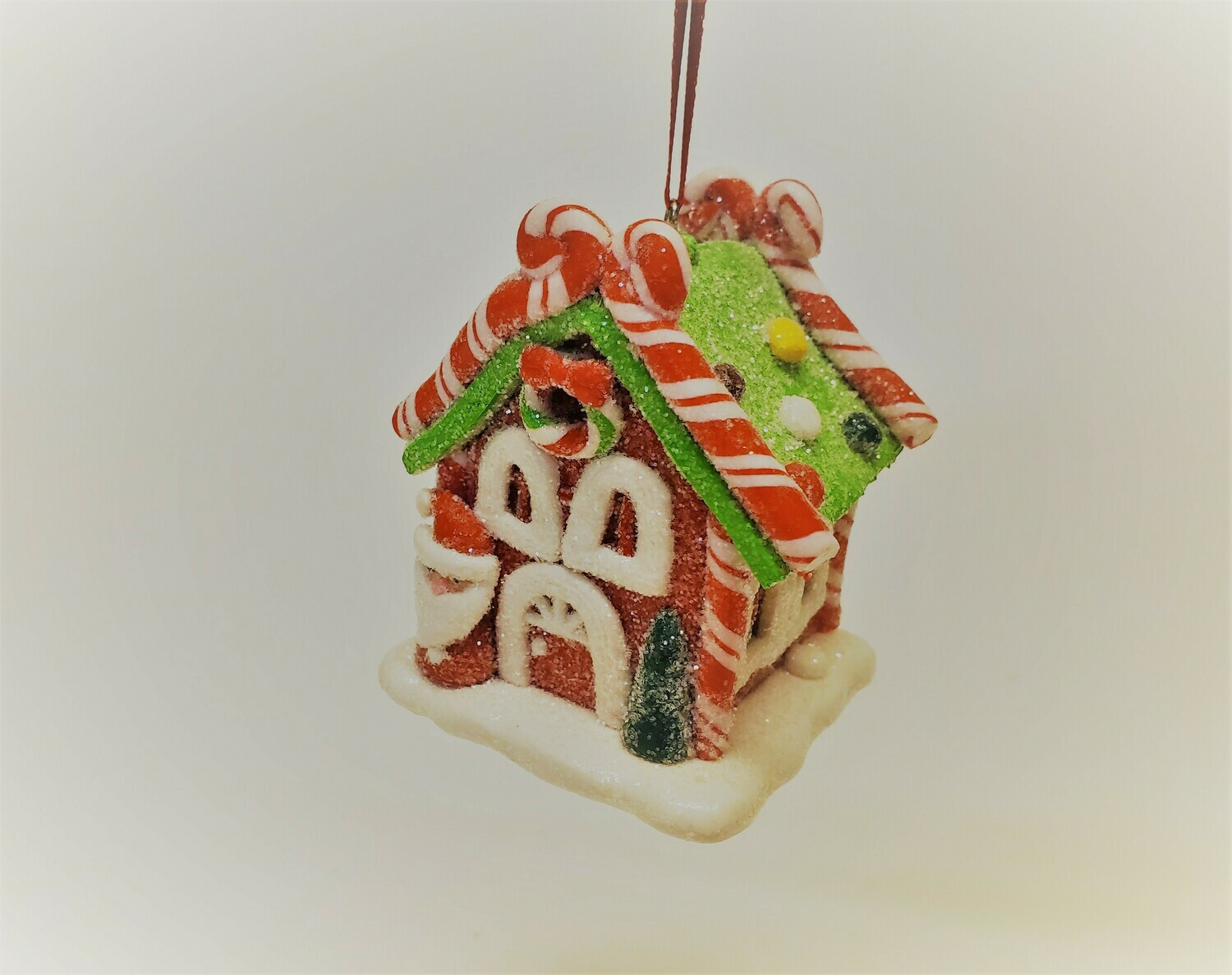 Red Gingerbread House with Santa