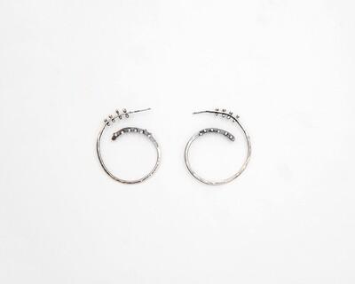 Lisa Colby: Spiral Rivet Hoop Earrings